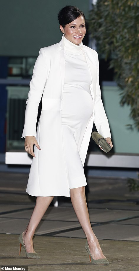 MEGHAN MARKLE WEARS WHITE AMANDA WAKELY COAT AND CALVIN KLEIN SWEATER DRESS TO NATIONAL HISTORY MUSEUM IN LONDON