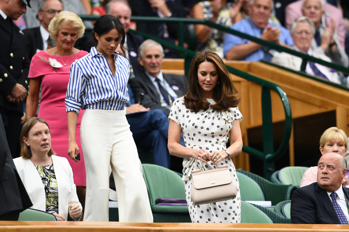 MEGHAN MARKLE WEARS A STRIPED RALPH LAUREN SHIRT AND WHITE WIDE LEG PANTS TO WIMBLEDON WITH KATE MIDDLETON