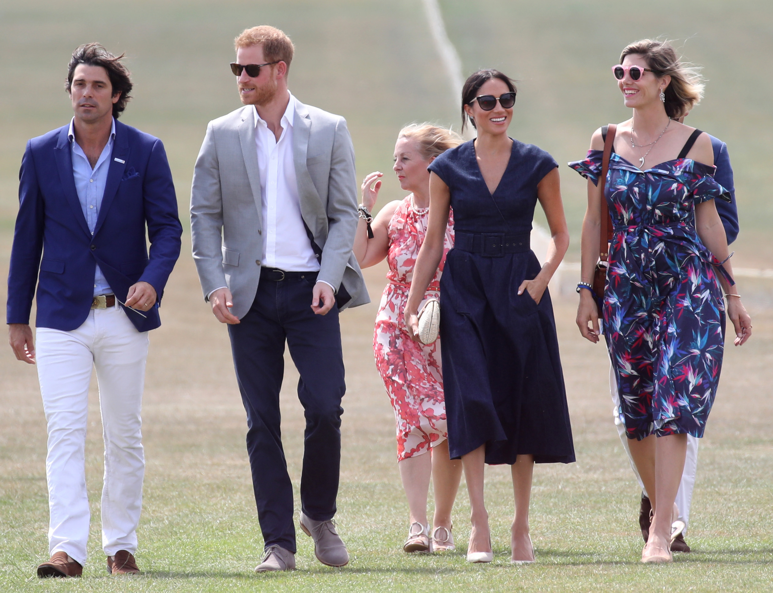 WINDSOR, ENGLAND - JULY 26:  (L-R) Sentebale Ambassador Nacho Figuares, Prince Harry, Duke of Sussex, Sentebale CEO Cathy Ferrier, Meghan Duchess of Sussex and Delfina Figueras arrive for the Sentebale Polo 2018 held at the Royal County of Berkshire Polo Club on July 26, 2018 in Windsor, England.  (Photo by Chris Jackson/Getty Images)