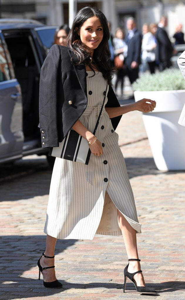 BGUK_1208102 - ** RIGHTS: WORLDWIDE EXCEPT IN FRANCE, UNITED KINGDOM ** London, UNITED KINGDOM  - Prince Harry and Meghan Markle attend a reception with delegates from the Commonwealth Youth Forum at the Queen Elizabeth II Conference Centre, London, UK, on the 18th April, 2018  Pictured: Meghan Markle  BACKGRID UK 18 APRIL 2018   UK: +44 208 344 2007 / uksales@backgrid.com  USA: +1 310 798 9111 / usasales@backgrid.com  *UK Clients - Pictures Containing Children Please Pixelate Face Prior To Publication*
